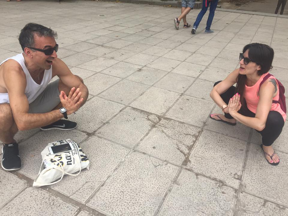 Life coach Chrisitan Pyrros doing yoga with a friend in spain